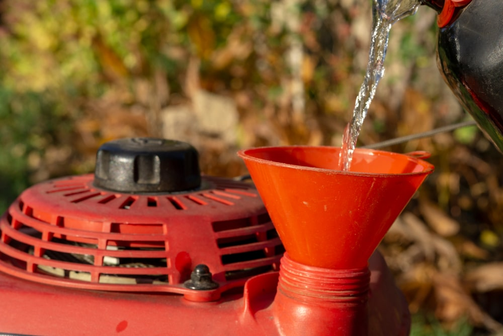 Changing oil in a lawn mower is an important part of maintenance.