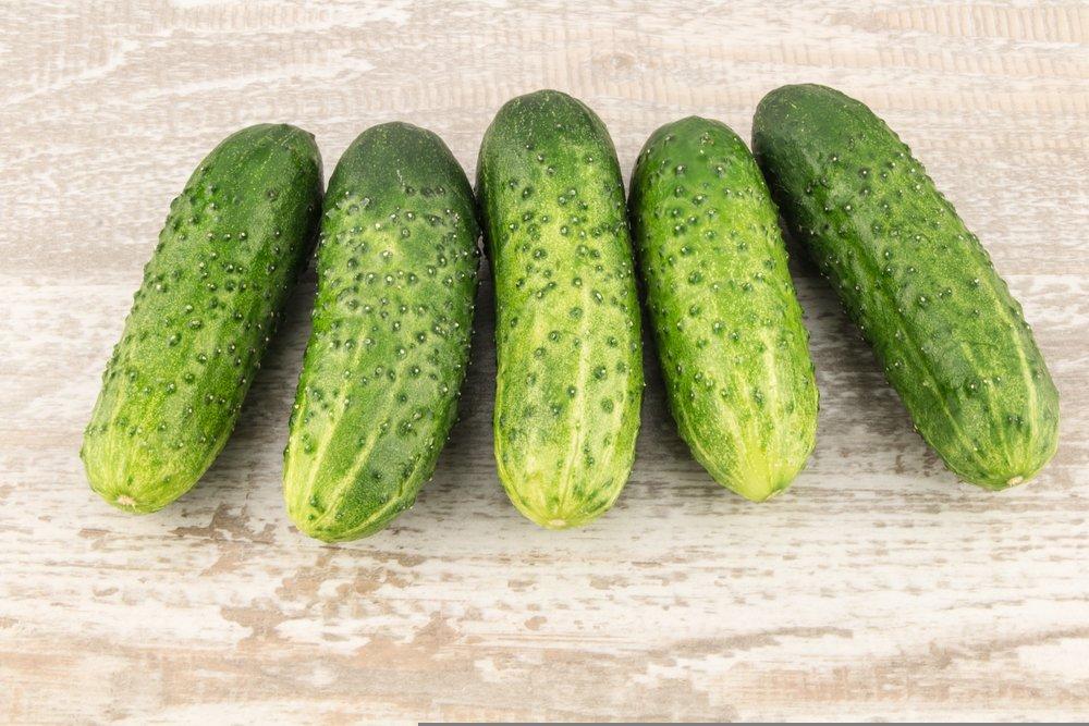 6 alibi cucumbers laying on a table