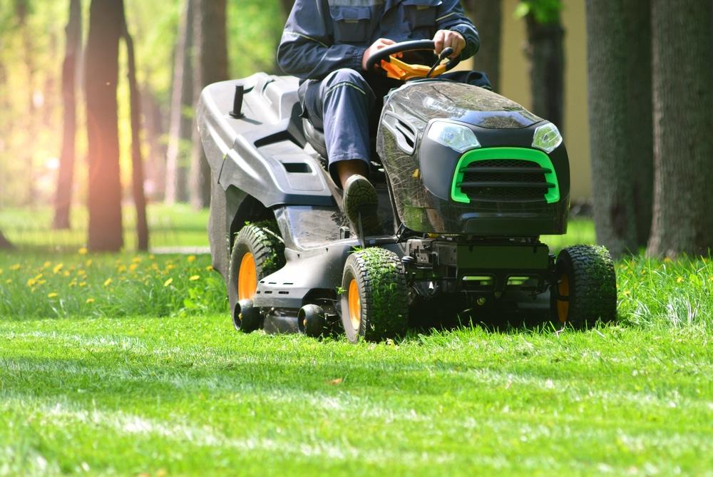 A man on a riding lawn mower