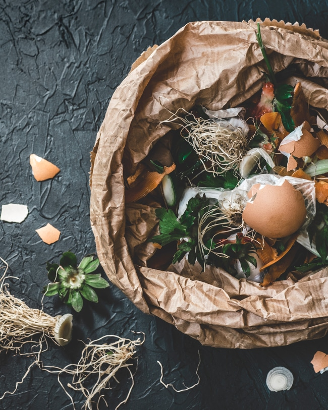 Green organic materials that can be part of a composting bin at home.