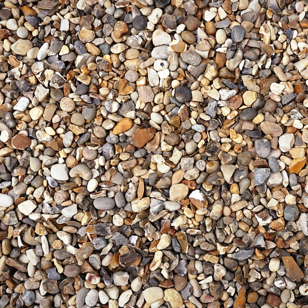 Pea gravel is a more inexpensive rock mulch