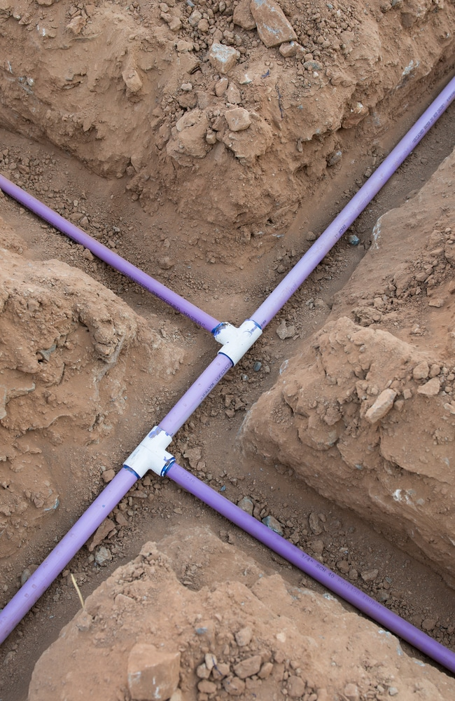 PVC pipes with the T connectors are the foundation for a sprinkler system