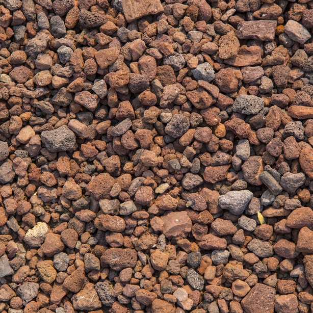 Red lava rocks can be used to stop weeds