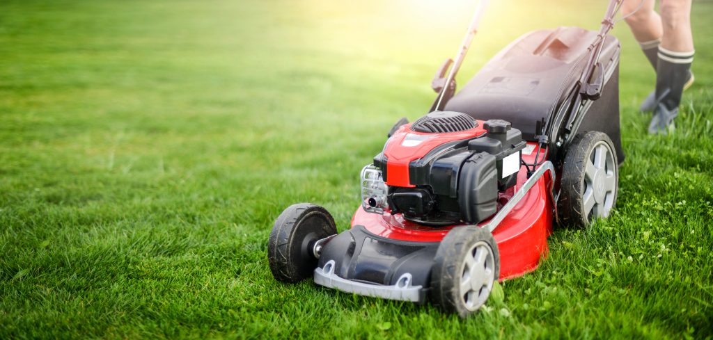 A red, push-style lawn mower.