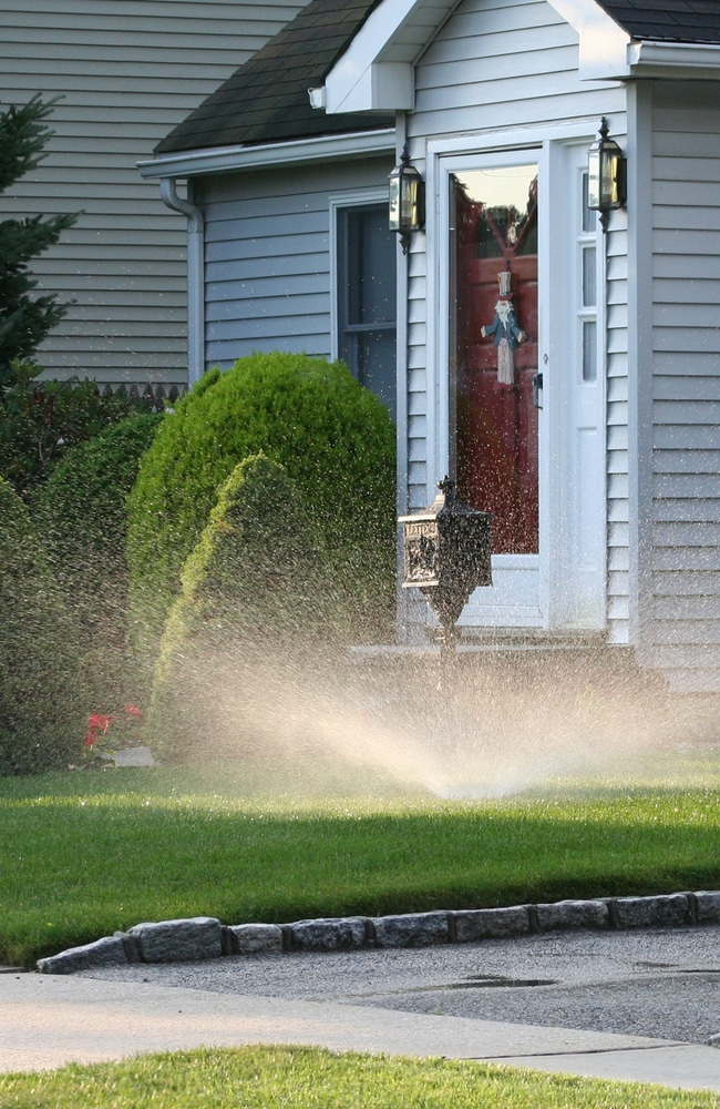 water spraying and covering all areas of a property