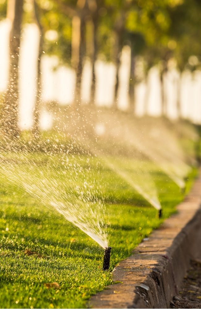 Sprinklers are watering lawn