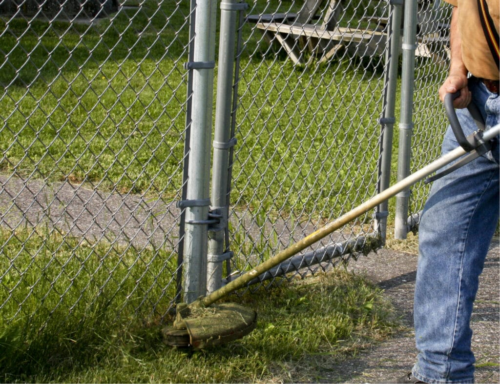 weed whacker may be good for getting rid of grass where lawn mowers cannot reach